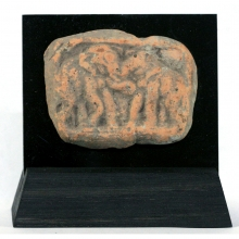 A Chandraketugarh clay plaque depicting two fighting elephants.