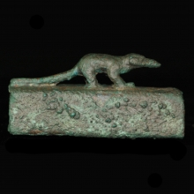 An Egyptian miniature bronze sarcophagus for an ichneumon (mongoose).