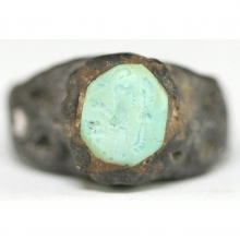 Neo-Assyrian silver ring with engraved turquoise bezel