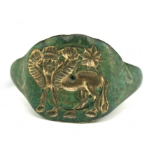 Neo-Assyrian bronze ring, the bezel depicting  a human headed winged horse.