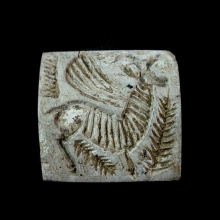 Bactrian steatite bead seal with a winged bull.