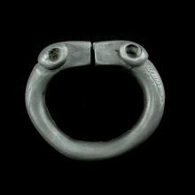 Central Asian solid silver bracelet with rams heads at terminals