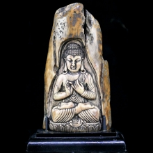 A Himalayan Buddhist ivory carving depicting Buddha