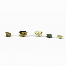 A group of 5 Late Period glazed faience eye of Horus amulets