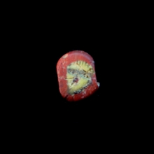 Roman Egyptian glass paste face bead.