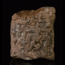 Sumerian clay tablet inside partial envelope with cuneiform inscription