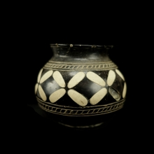 Bactrian black stone vessel with floral limestone inlay