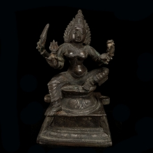 South Indian copper alloy seated figure of Durga, 18th Century