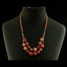 A Thai glass and carnelian bead necklace