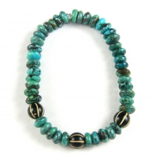 A bracelet comprising Himalayan discoid turquoise beads and round Pumtek  beads