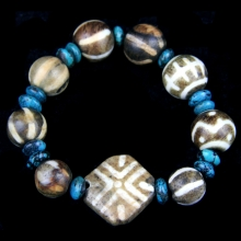 A bracelet comprising Himalayan turquoise discoid beads and Pumtek beads.
