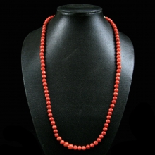 A necklace comprising Mediterranean (Sardinian) natural red coral round beads with 18 carat gold elements