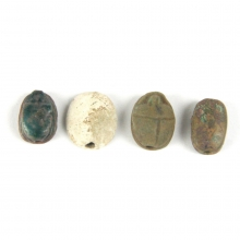 A group of 4 Late Period to Ptolemaic Scarabs of bronze and faience, Ex Kovar Collection