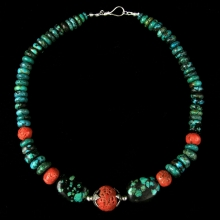 Himalayan necklace comprising, turquoise, coral and silver beads.