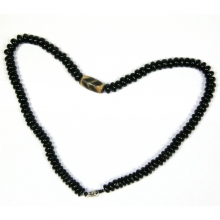 Black onyx mala with tiger tooth bead