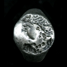 An Indo-Greek silver ring the intaglio depicting a female head in profile