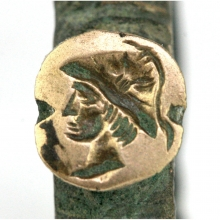 Bactrian bronze ring the bezel engraved with a royal figure wearing helmet