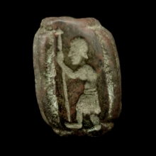 Bactrian bronze barrel shaped bead with Warrior stamp.
