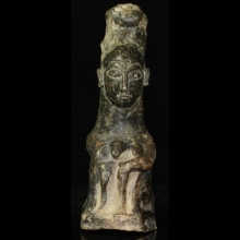 Bactrian clay figurine of a seated deity.