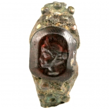 Roman bronze ring with garnet bezel depicting a female head in profile
