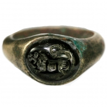 Roman bronze ring with garnet bezel depicting a rampant lion