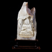 A Mammoth ivory carving depicting an image of the seated Buddha
