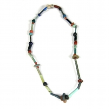 An Egyptian faïence, rock crystal, and glass bead necklace.