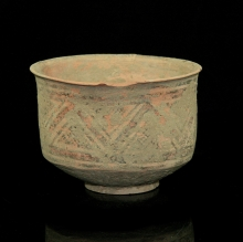 An Indus Valley Mehrgarh pottery vessel with painted geometric designs