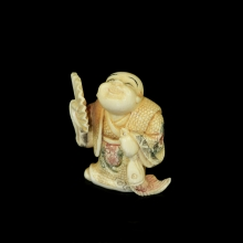 Japanese painted ivory Netsuke carving of a young boy