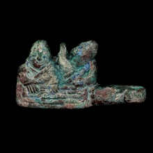 A Han Dynasty bronze belt buckle depicting a pair of musicians.