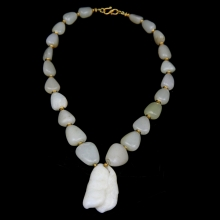 Qing Dynasty white jade necklace with modern gold elements.
