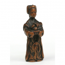 Japanese boxwood Netsuke carving of a Chinese woman holding a basket of fruit,  Edo to Meiji