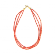 A three tiered necklace comprising Mediterranean (Sardinian) natural red coral barrel shaped beads with 18 carat gold elements