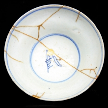 A Qing blue and white bowl with Kintsugi repair