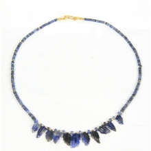 A necklace comprising Indian natural sapphire beads gold elements and carved sapphire leaf pendants.