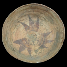 Egyptian Nubian clay ware bowl with radiating motif in brown pigment.