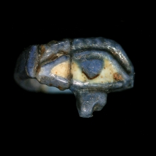Egyptian blue and white faïence ring with eye of Horus bezel, 18th - 19th Dynasty