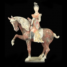 A Chinese Tang Dynasty pottery hose with Court lady