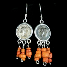 A pair of earrings with central Bactrian empire silver coated copper coins with glass paste beads.