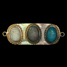 A group of three New Kingdom faïence scarabs set in modern gold pendant mount