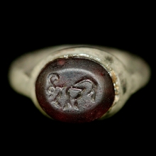 Roman silver ring with amethyst bezel depicting a ram