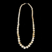 A pre-ban ivory graduated bead necklace.
