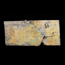 An Egyptian wood and gesso painted Sarcophagus fragment.