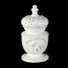 A Victorian carved and polished ivory pepper shaker