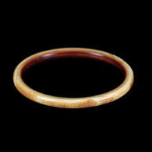A Victorian carved and polished ivory bangle
