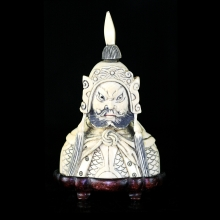 A Qing to Republic carved ivory snuff figurative bottle in warrior / warlord form