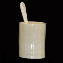 A Victorian carved and polished ivory sugar bowl and spoon.