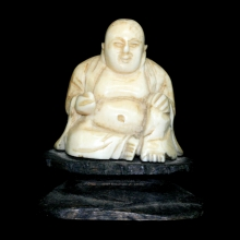 A Qing carved ivory seated lucky Buddha