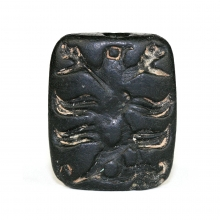 A Bactrian black stone seal amulet the impression depicting a camel and avian figure.