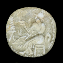 Bactrian sandstone stamp seal depicting a Seated God and Warrior